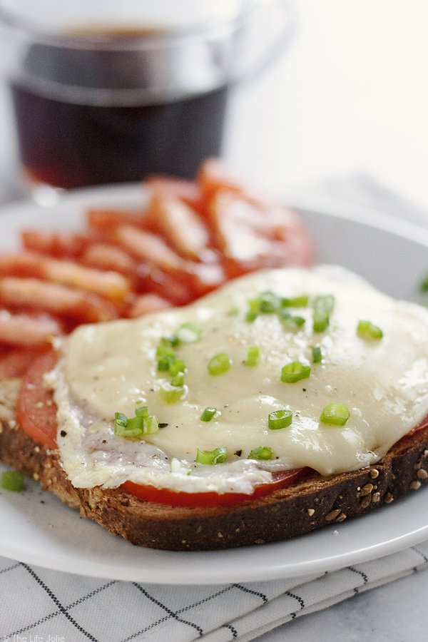 This Open-Faced Egg Sandwich is the best easy recipe option to throw together in the morning. Made with toast, fried eggs, cheese and tomatoes it's a healthy and delicious way to start the day!