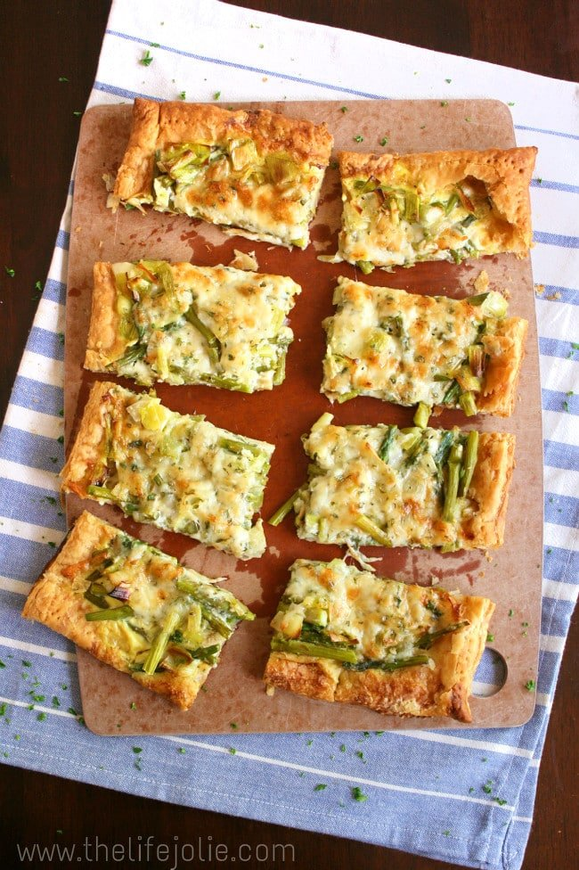 This Asparagus and Leek tart has the most amazing flavor combination from the addition of Gruyere cheese and fresh herbs. It is quick and easy to put together and the results are delicious!