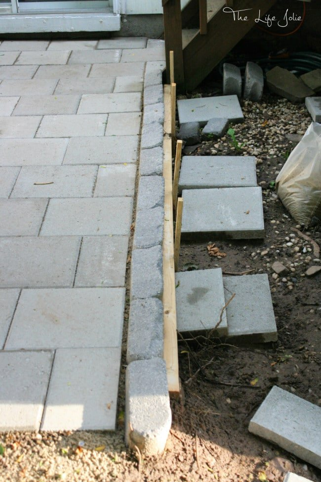 Img6263 e1435923657543g this diy paver patio was actually a much more manageable project than we expected here solutioingenieria Image collections