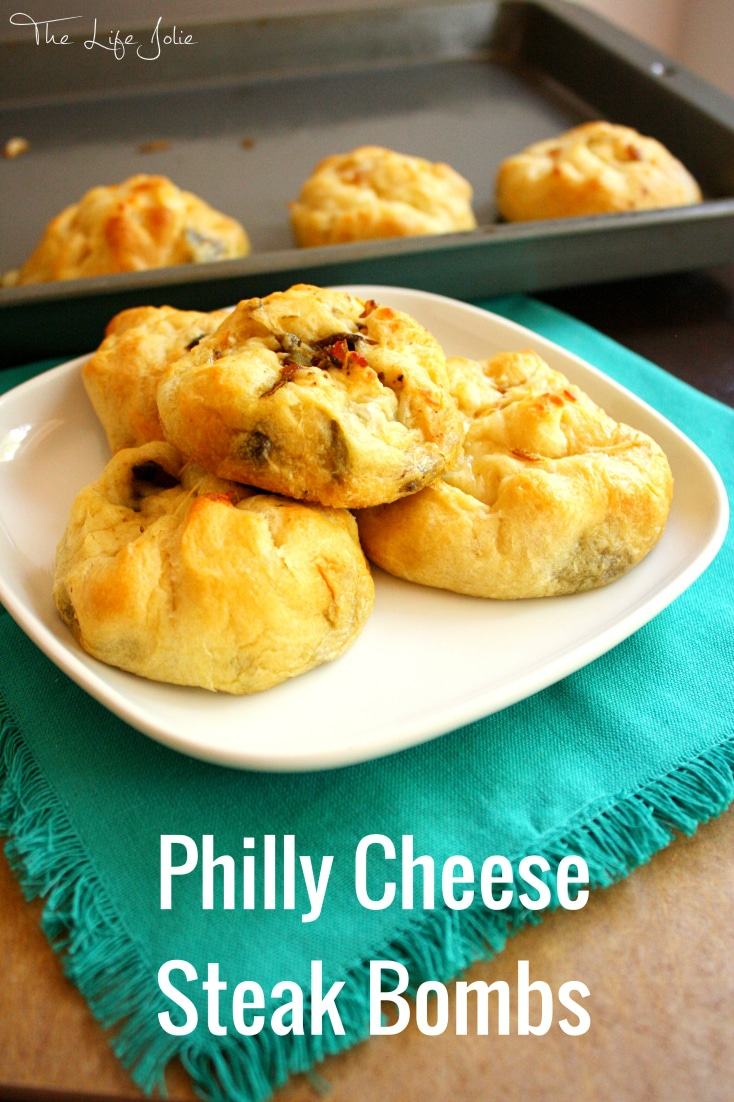 These Philly Cheese Steak Bombs are such an awesome game day snack- they are savory and delicious and so addictive, you'll definitely want to make multiple batches! Click on the photo to read more!