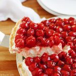 Rosie's Award Winning Cherry Cheese Pie is a favorite family recipe- it is insanely easy and heavy cream, cream cheese, vanilla, confectioner's sugar and cherries make up the minimal ingredients. It looks gorgeous on any dessert tables, especially for the holidays and could not be more delicious! Get in the kitchen and make this now!