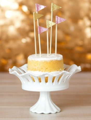 These DIY Flag Cake Toppers are perfect for a custom birthday or a wedding cake! They are so easy to make and can be personalized in whatever unique way you'd like!