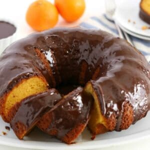This Orange Cake with Chocolate Ganache Glaze is super easy to make. It's a cake mix hack recipe that comes out so moist and delicious- this one's a keeper!
