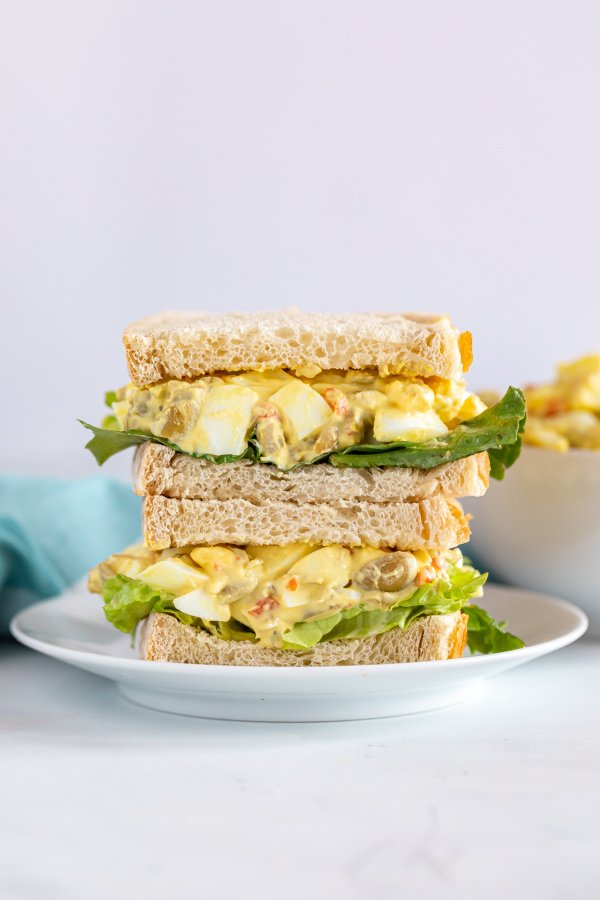 Egg salad sandwiches stacked on each other