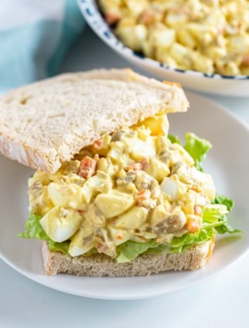 An Egg Salad Sandwich with Olives is an excellent and healthy way to take a basic egg salad sandwich recipe and make it extra special. It's quick and easy to make and a great way to use hardboiled eggs and make a tasty sandwich for lunch.