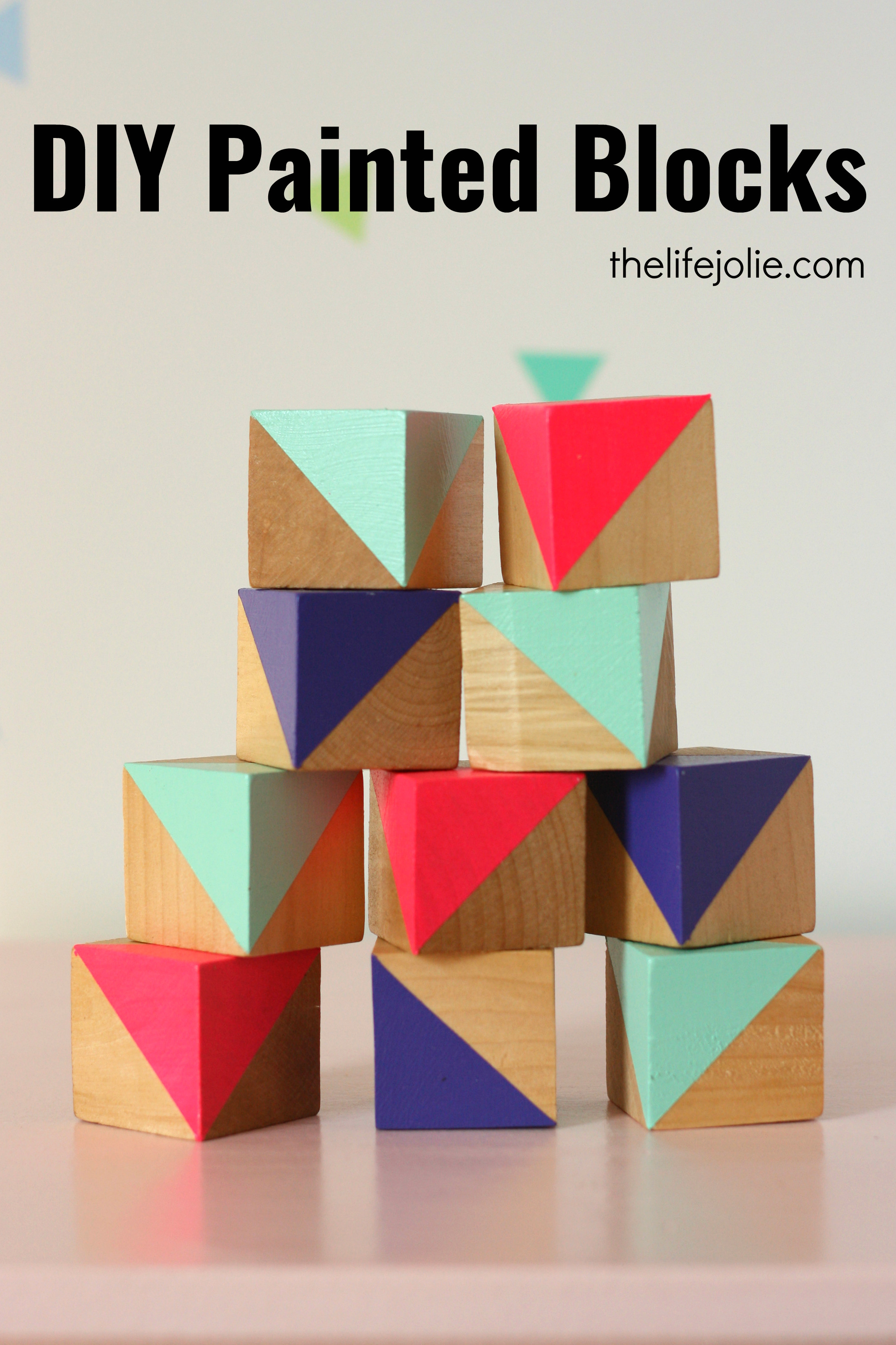 These DIY painted blocks are a fun way to add a decorative, colorful accent into a kids room or nursery. They're very easy to make with this simple tutorial and look so cute!