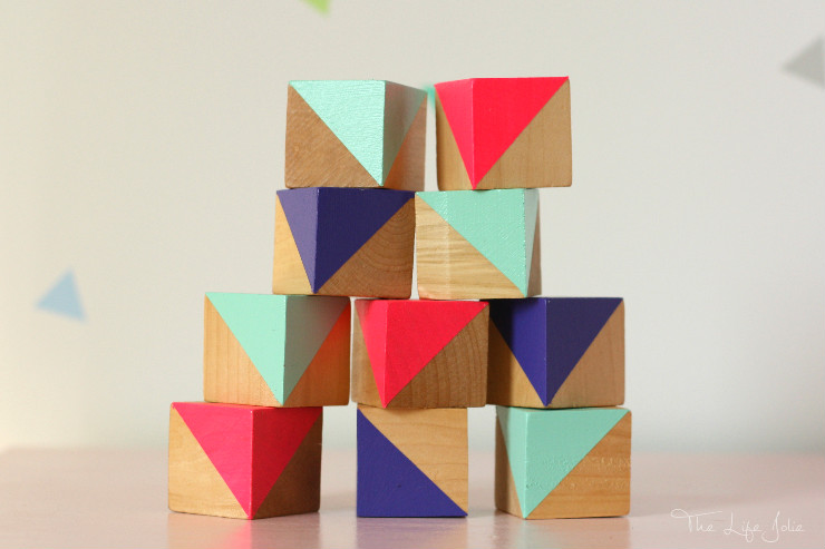 These DIY painted blocks are a fun way to add a decorative, colorful accent into a kids room or nursery. They're very easy to make with this simple tutorialand look so cute!
