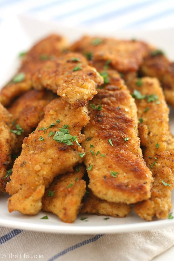 This Chicken Cutlets recipe is an easy Italian weeknight dinner option. It's a healthy chicken dish that is breaded and lightly fried and then finished in the oven. They're super tender and have amazing flavor!