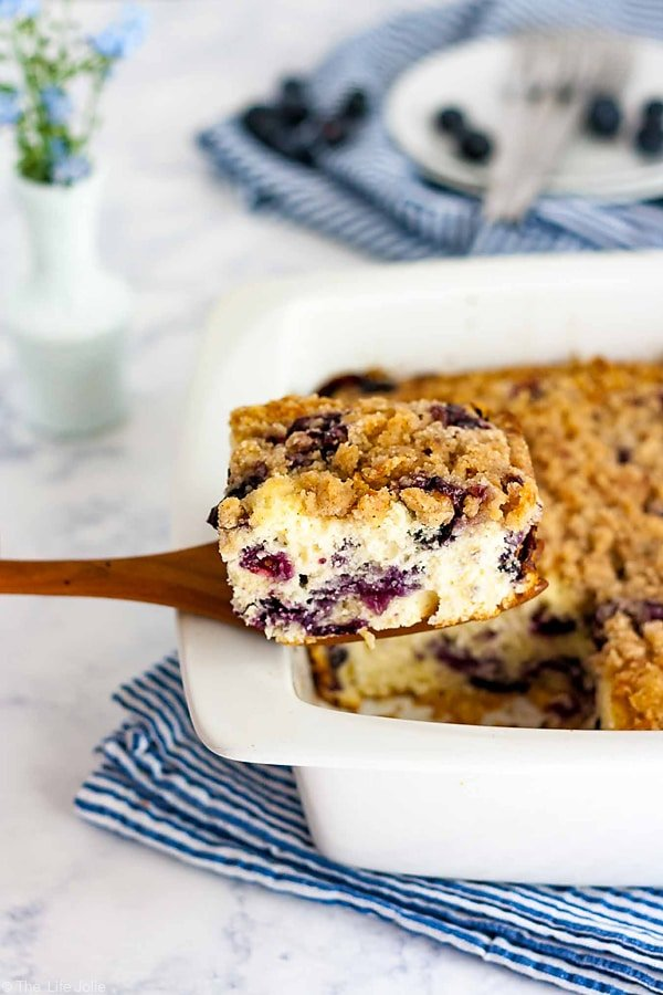 A piece of Blueberry Buckle beeing pulled up and out of the pan.