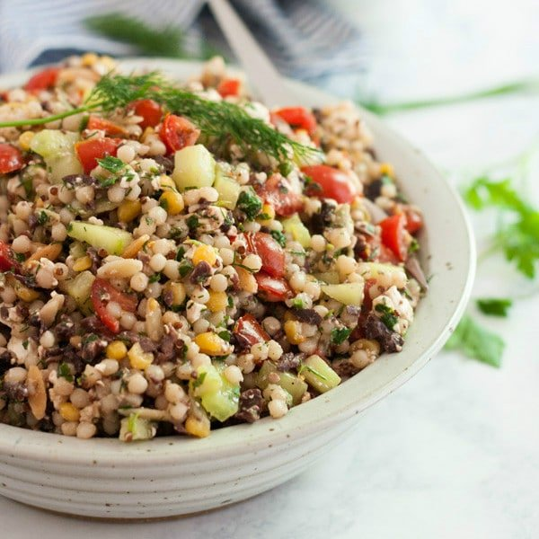 This Greek Couscous Salad recipe is a light and healthy side dish for lunch or dinner. It's quick and easy to make and is full of delicious flavors of Feta cheese, vegetables, olives and fresh herbs. Click on the photo to get the recipe!