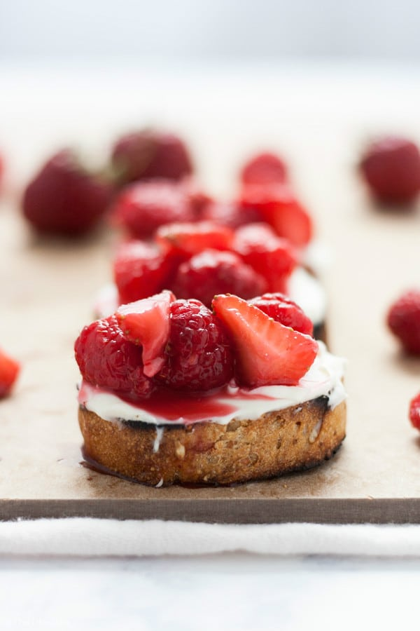 This Summer Berry Dessert Crostini recipe is a light and delicious summer dessert. You can also call it dessert bruschetta. It uses ripe summer berries, mascarpone cheese sweetened with honey and grilled baguette. This easy dessert is super quick to make and a real crowd pleaser!