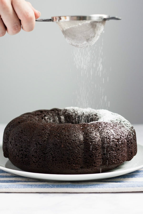 This quick and easy Chocolate Pudding Cake recipe is a delicious cake mix hack! There are only five simple ingredients and the result is the most perfectly moist cake you'll ever taste. This is an awesome last-minute dessert to throw together and it's so good that people will have no idea it's from a box! Click on the photo to get the recipe!