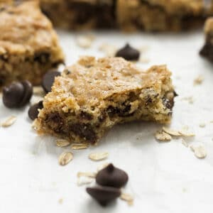 This Cherry Oatmeal Chocolate Chip Bars recipe makes a great lunchbox treat and party snack! These chewy treats have dark chocolate chips and dried cherries. They're quick and easy to make and a huge hit with the whole family!