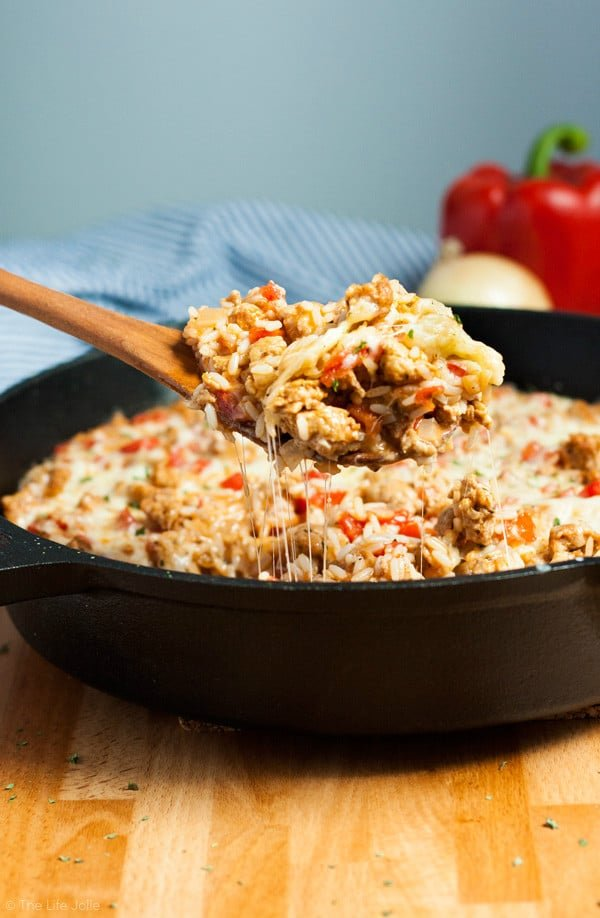 This 30 Minute Stuffed Peppers Rice Skillet recipe is the perfect dinner for a busy weeknight. This easy dinner comes together in just 30 minutes and you can use Turkey Sausage to make it a healthy option. It's cheesy, delicious and full of flavor- perfect for busy nights when the kids are back-to-school! Click on the photo to get the recipe!