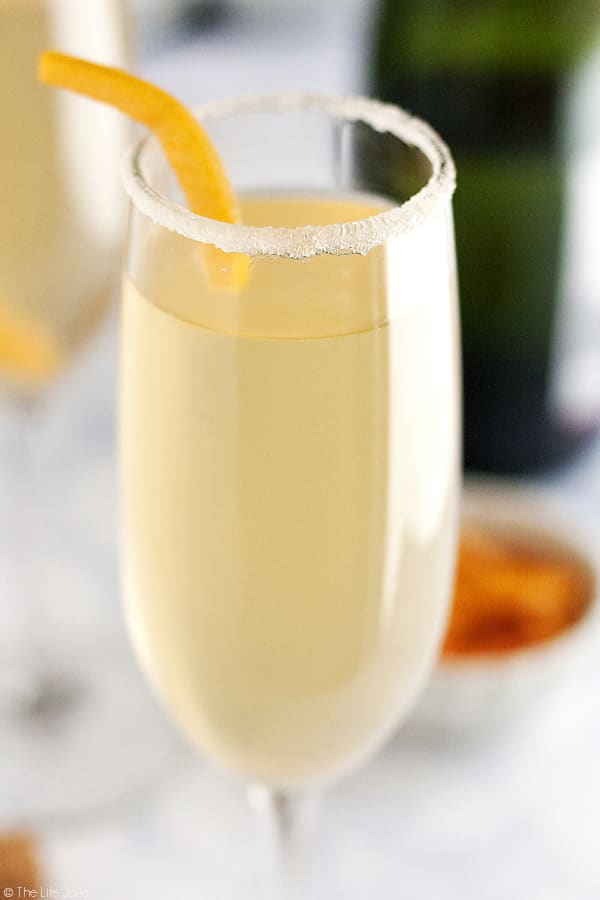 This Grapefruit Sparkler is a festive champagne cocktail! I love adult beverages featuring sparkling wine and this is simple to make and refreshing to drink at brunch or to ring in the New Year. This pretty drink will be a mainstay at your next girls night!