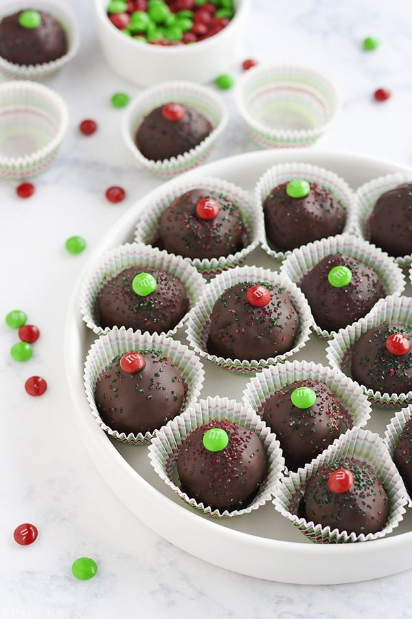 These M&M's Brownie Truffles are an easy chocolate dessert recipe and an excellent gift to give this holiday season. It's a super-simple recipe made with rich, fudgy brownies and a surprise in the middle. These are a pretty addition to any Christmas cookie platter that the whole family will love!