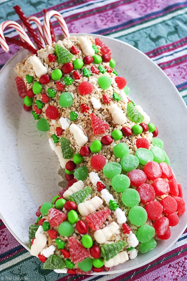 This Rice Krispie Treat Stocking recipe is an easy Christmas dessert option for both kids and adults! It was simple to make and decorate and is meant to be made ahead. This is a fun project for the whole family to make during the holidays and is a great Gingerbread House alternative.