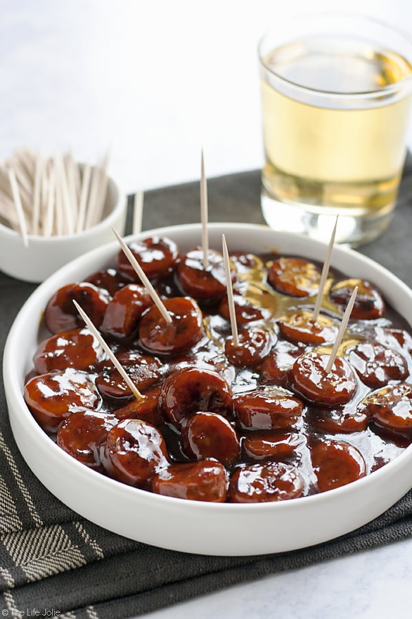 These Sweet and Spicy Kielbasa Bites are such an easy recipe! Just 3 simple ingredients and they're ready in around 20 minutes. These glazed sausage bites are sure to be a hit at any holiday or game day party!