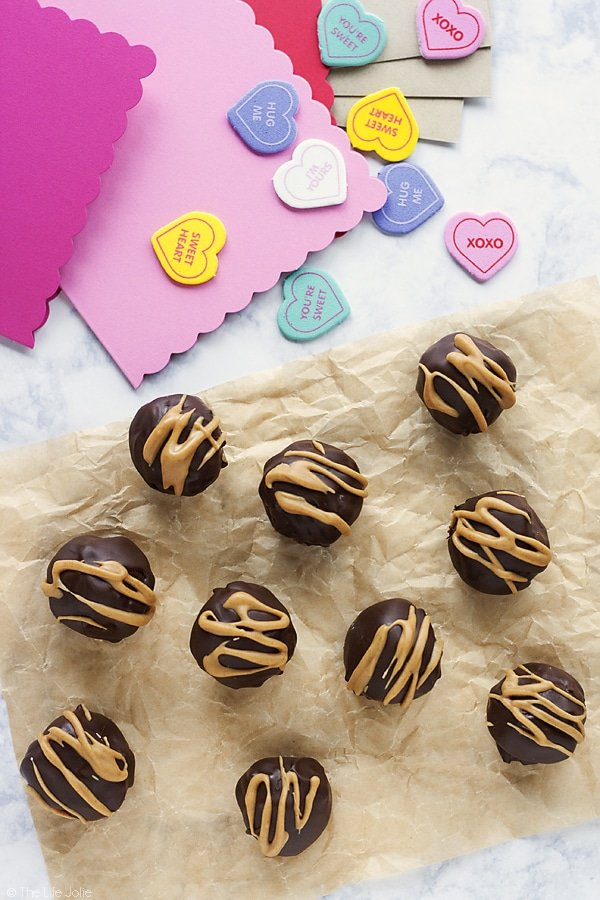 These Peanut Butter Brownie Truffles are an easy chocolate dessert recipe and an excellent gift to give this for Valentine's Day. This simple recipe is made with rich, fudgy brownies and a peanut buttery surprise in the middle.