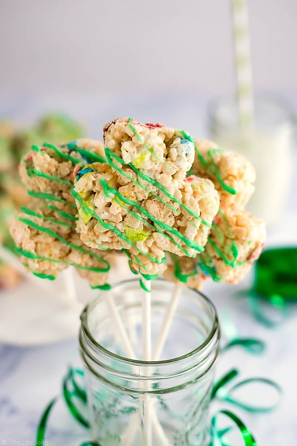 These Lucky Charms Treats are a super easy and fun dessert recipe to celebrate St. Patrick's Day with the kids! They're made with Rice Krispies and the marshmallows from Lucky Charms and drizzled with white chocolate that's been dyed green. These snacks are such a fun option to bring to parties and get-togethers!