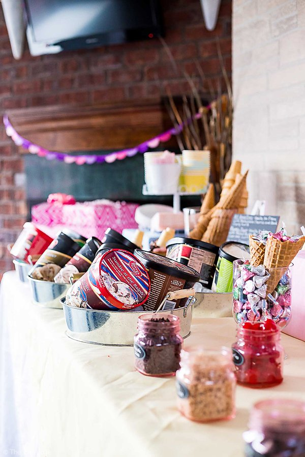 This Ice Cream Social Birthday Party couldn't be cuter! Complete with a dessert table / sundae bar decorated to look just like the outside of a vintage ice cream parlor, there are so many fun details and delicious sweets! There's also several free printables to subscribers, great for a kids birthday party or a bridal shower! #ad