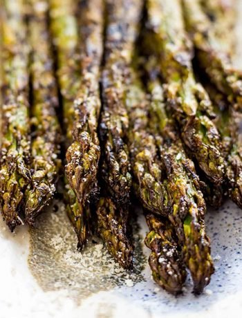 This easy Balsamic Grilled Asparagus recipe is the absolute best way to cook asparagus! It only takes 15 minutes and cooks up perfectly on your BBQ  for a simple, crispy, healthy and flavorful summer side dish.