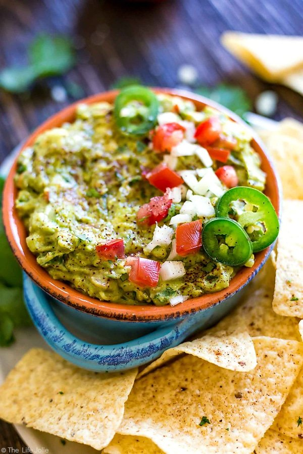 It's always a good idea to have an easy guacamole recipe up your sleeve and this one is seriously the best- fantastic, zesty flavor with an awesome secret ingredient to helps take the guacamole to the next level. It's a healthy snack for any celebration or game day!