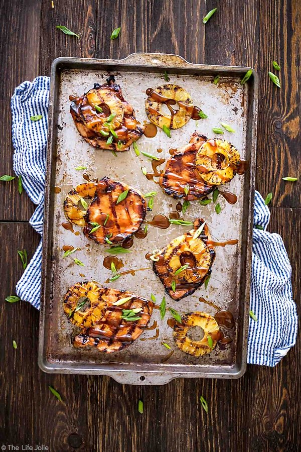 These Grilled Hawaiian Pork Chops are an easy recipe for a quick weeknight dinner. It's really easy to marinate in things like soy sauce and brown sugar and goes great with grilled pineapple and rice. This mouthwatering sweet and savory dish is the perfect summer meal! #ad