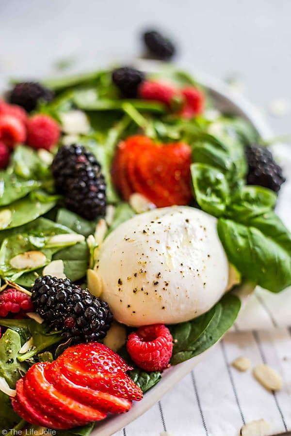 A close up of the Burrata cheese in this Summer Berry and Burrata Salad.