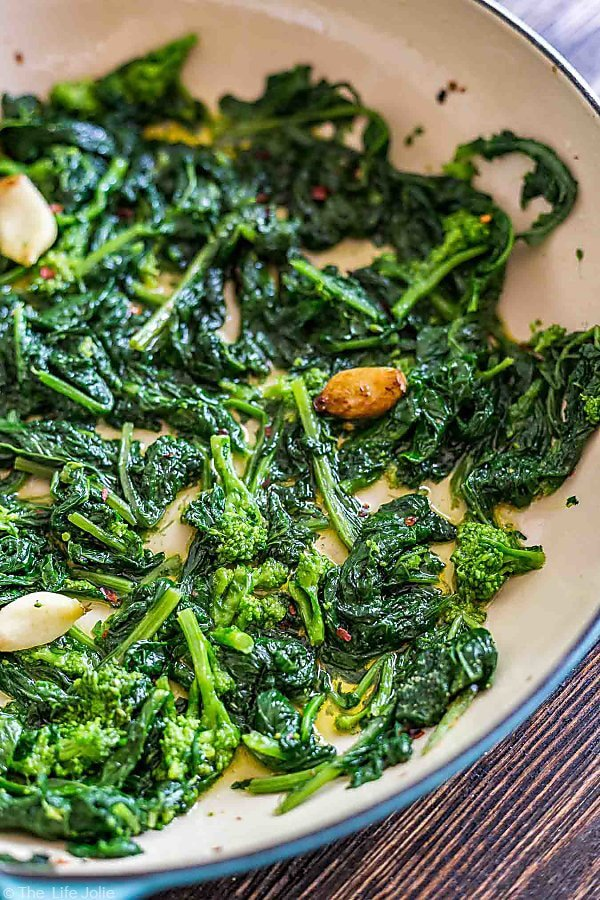 Another overhead shot of a pan of Broccoli Rabe with Garlic showing about three quarters of a pan.