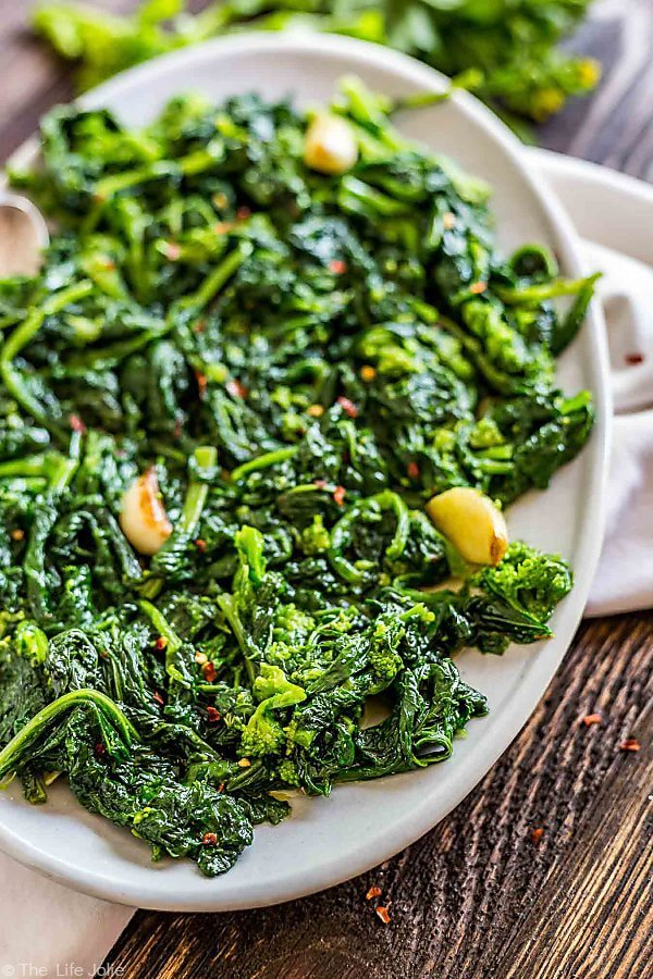A plate of Broccoli RAbe with Garlic on an oval plate with the left side of the plate cut off.