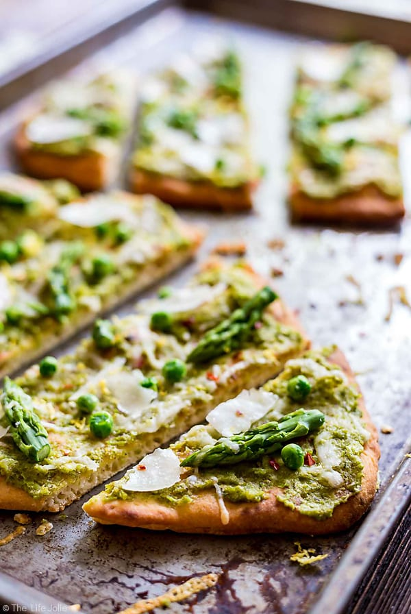 CLose up photo of slices of Pea Pesto Flatbread.