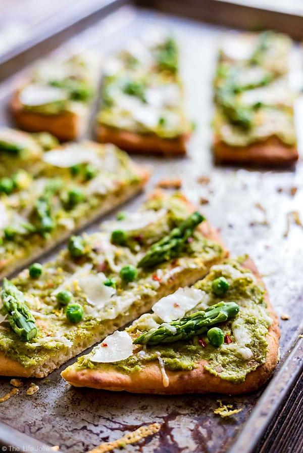 CLose up photo of slices of Pea Pesto Flatbread.
