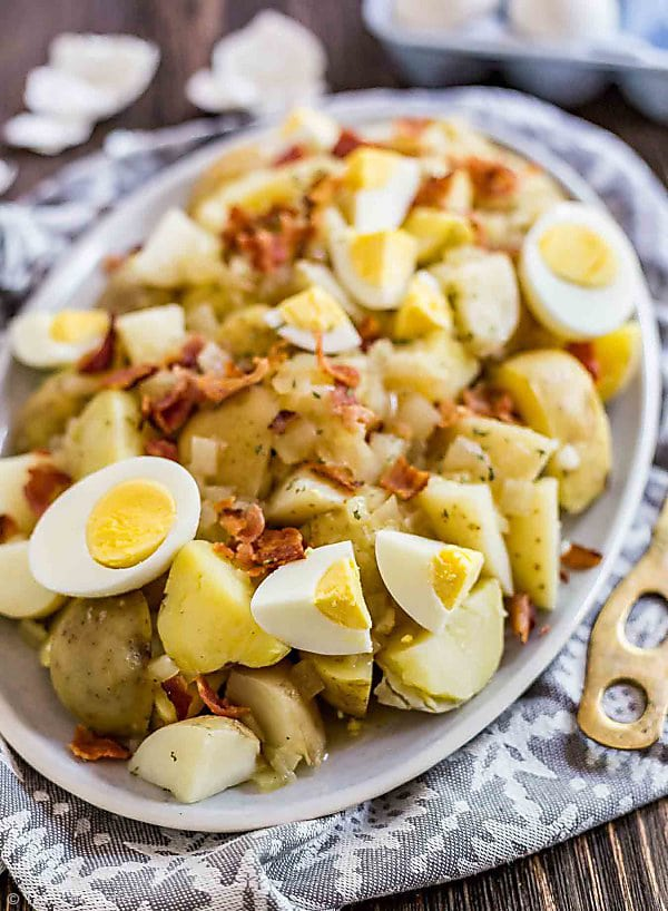 A plate of German Potato Salad with egg shells in the background.