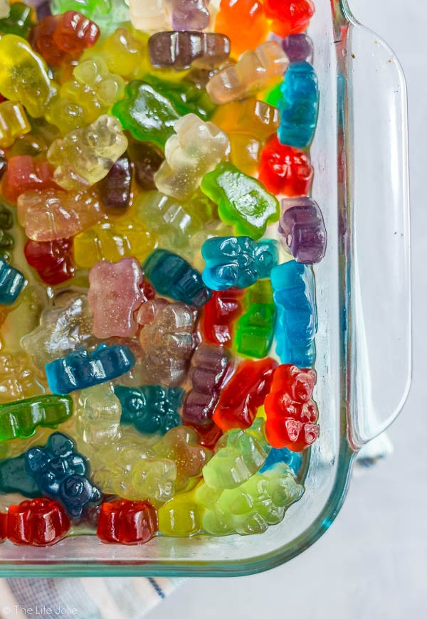 An overhead shot of the corner of the square glass container of Boozy Gummy Bears.