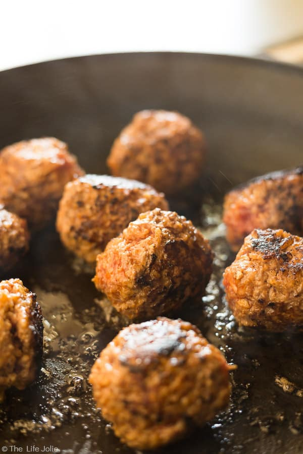 Classic Porcupine Meatballs browning in a pan.