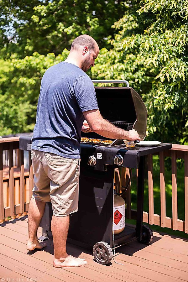 A shot of Justin grilling Sweet Chili Turkey Burgers in the afternoon on our grill.