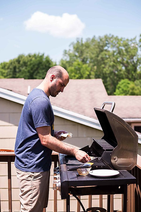 A profile photo of my husband Justin grilling Sweet Chili Turkey Burgers.