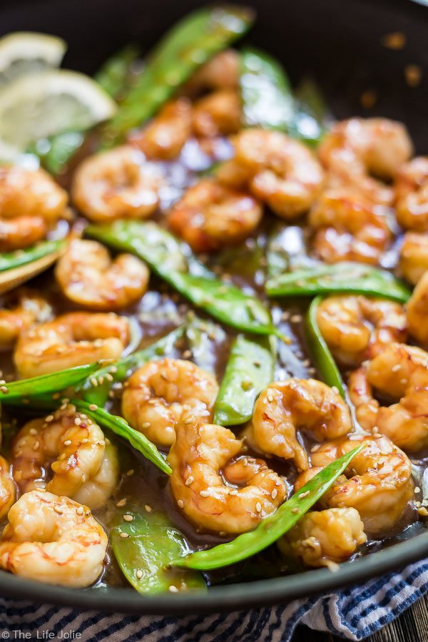 A close up image of Shrimp and Snow Peas Stir Fry in a pan.