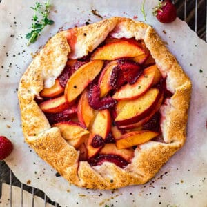 A square image of Nectarine and Strawberry Galette with Thyme.