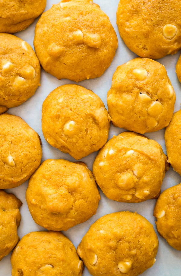 An overhead image of White Chocolate Macadamia Nut Pumpkin Cookies laid out.