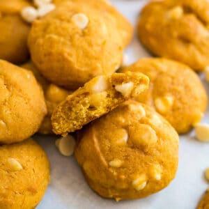 A square image of White Chocolate Macadamia Nut Pumpkin Cookies.