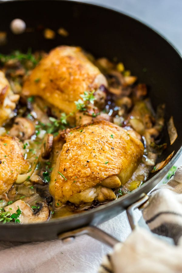 A close up shot of Champagne Braised Chicken Thighs in a pan.
