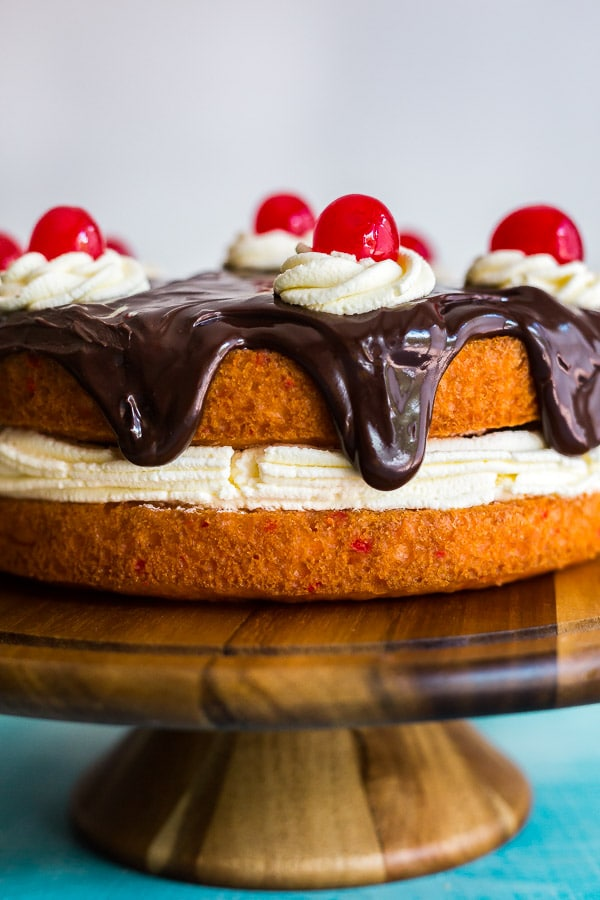 A close up image of the side of the Strawberry Banana Split Cake.