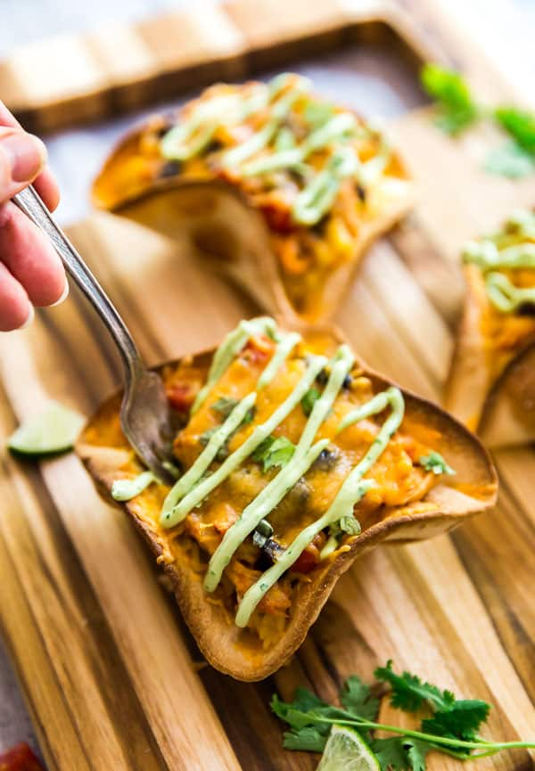 A hand with a fork taking some Cheesy Chicken Taco Bowls