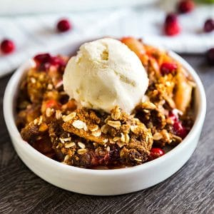 A square image of Cranberry Apple Crisp Recipe with Oatmeal Ginger Snap Topping.