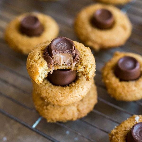 A square image of Salted Caramel Blossoms Cookies.