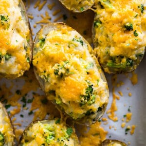 A square image of Cheddar and Broccoli Twice Baked Potatoes