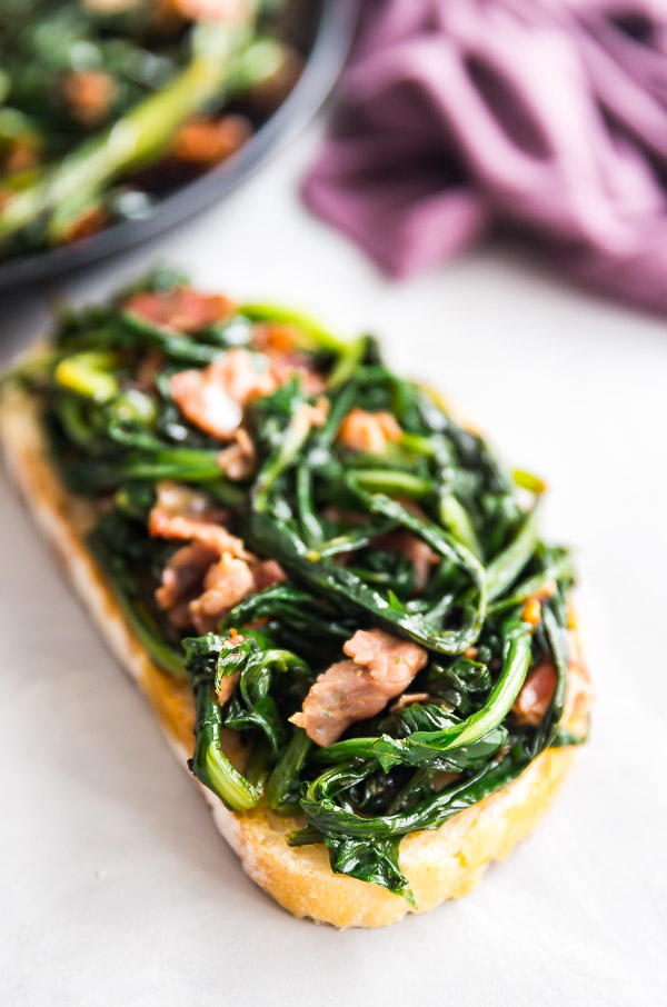 A picture of Spicy Dandelion Greens with Capicola on a piece of IT\talian bread.