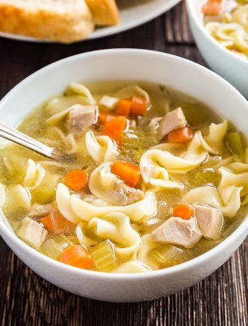 A square image of a bowl of Easy Homemade Chicken Noodle Soup.
